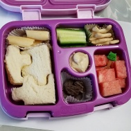 """09.13.17    Egg salad sandwich puzzle; some Trader Joe's breadstick crackers; cucumbers; animal crackers; watermelon; semisweet """"super"""" chocolate chips from Guittard chocolate; and hummus for dipping"""