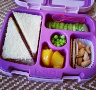 Practice 09.01.17    egg salad sandwich; cucumber slices; roasted and unsalted cashews; a Milano cookie; diced peaches; frozen peas