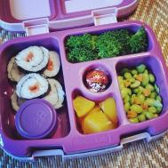 Practice 09.04.17    smoked salmon sushi rolls (with a little bit of ponzu sauce in the small container for dipping); steamed broccoli; edamame with some little heart shaped carrots; diced peaches; and a Lindt chocolate ball for something sweet