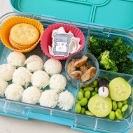 02.06.18 :: A dozen rice balls; some Ritz crackers for snack time later; teriyaki chicken; steamed broccoli; edamame; cucumber slices; and ponzu sauce in a little squirt bottle