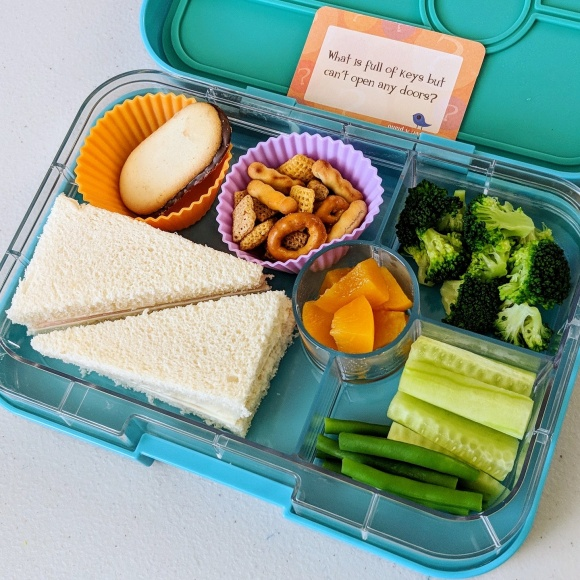 02.26.18 :: Turkey and cheese sandwich, a Milano cookie as a treat, Chex mix, diced peaches, steamed broccoli, cucumber sticks, and green beans